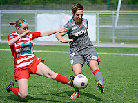 20140419 - ANTWERPEN , BELGIUM : Standard's Maud Coutereels (right) pictured with tackling Antwerp Stefanie Van Broeck (left) during the soccer match between the women teams of RAFC Antwerp Ladies  and Standard Femina  , on the 24th matchday of the BeNeleague competition on Saturday 19 April 2014 in Deurne .  PHOTO DAVID CATRY
