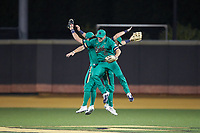 Notre Dame Fighting Irish outfielders Eric Gilgenbach (15), Brooks Coetzee (42), and Spencer Myers (2) celebrate their win over the Wake Forest Demon Deacons at David F. Couch Ballpark on March 10, 2019 in  Winston-Salem, North Carolina. The Fighting Irish defeated the Demon Deacons 8-7 in 10 innings in game two of a double-header. (Brian Westerholt/Four Seam Images)