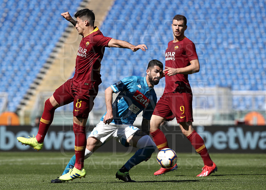 Football, Serie A: AS Roma - SSC Napoli, Olympic stadium, Rome, March 31, 2019. <br /> Napoli's Helseid Hysaj (c) in action with Roma's Diego Perotti (l) and Edin Dzeko (r) during the Italian Serie A football match between Roma and Napoli at Olympic stadium in Rome, on March 31, 2019.<br /> UPDATE IMAGES PRESS/Isabella Bonotto