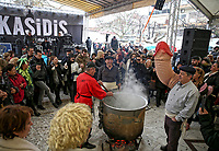 Pictured: People dance around the cauldron cooking spinach soup in Tirnavos, central Greece. 19 February 2018<br /> Re: Bourani (or Burani) the infamous annual carnival which dates to 1898 which takes place on the day of (Clean Monday), the first days of Lent in Tirnavos, central Greece, in which men hold phallus shaped objects as scepters in their hands.