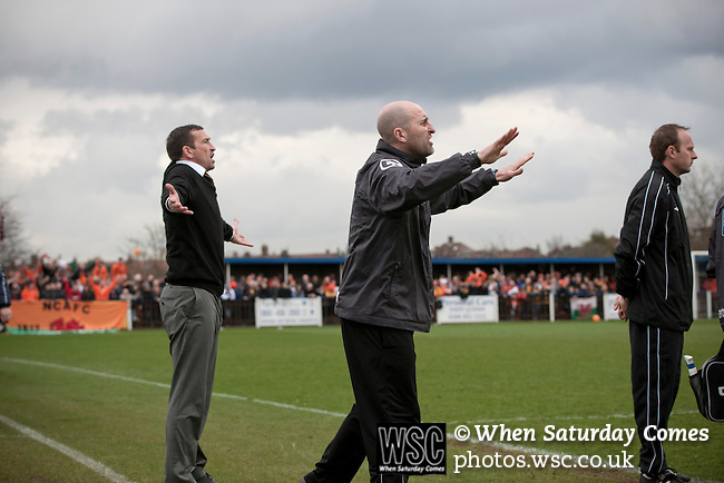 Wealdstone 0 Newport County 0, 17/03/2012. St Georges Stadium, FA Trophy Semi Final. Visiting manager Justin Edinburgh (left) and his assistant Jimmy Dack gesturing to their players at St Georges Stadium, home ground of Wealdstone FC, as the club played host to Newport County (yellow) in the semi-final second leg of the F.A. Trophy. The game ended in a goalless draw, watched by a capacity crowd of 2,092 which meant the visitors from Wales progressed by three goals to one to the competition's final at Wembley, where they would meet York City. The F.A. Trophy was the premier cup competition for non-League clubs in England and Wales affiliated to the Football Association. Photo by Colin McPherson.