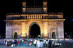 MUMBAI, INDIA - SEPTEMBER 27, 2010: The night time scene of the Gateway to India outside the  Taj Mahal Palace and Tower Hotel in Mumbai. The hotel has re-opened after the terror attacks of 2008 destroyed much of the heritage wing. The wing has been renovated and the hotel is once again the shining jewel of Mumbai. pic Graham Crouch