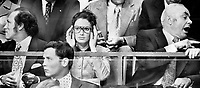 Divergence of interest: While Margaret Trudeau; adjusting her glasses; finds action on ice well worth watching; her companions in box at Maple Leaf Gardens are distracted. Prime Minister Pierre Trudeau glances off to left; where something has caught his attention. And Boris P. Miroshnichenko; ambassador from Soviet Union; engages in pointed discussion with another member of the group from Ottawa.<br /> <br /> Photo : Boris Spremo - Toronto Star archives - AQP