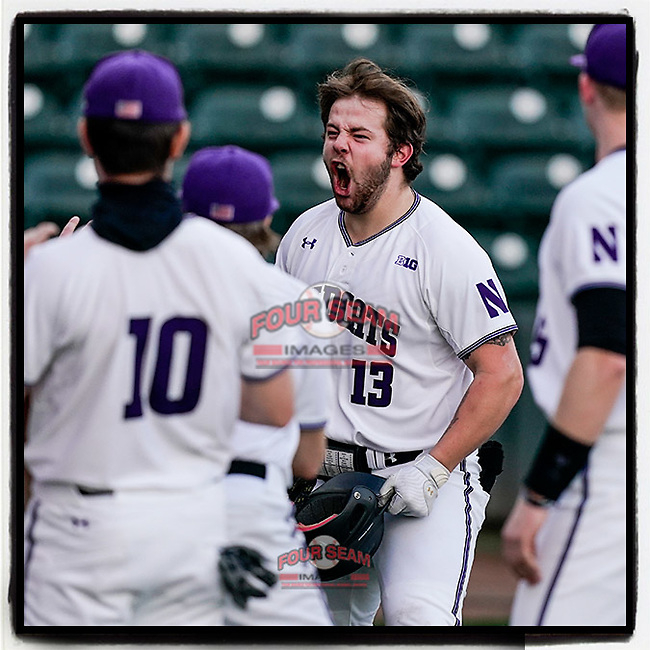 Designated hitter Stephen Hrustich (13) of the Northwestern Wildcats is greeted after hitting a grand slam home run in the second inning of a game against the Michigan State Spartans on Friday, March 12, 2021, at Fluor Field at the West End in Greenville, South Carolina. Northwestern won, 14-2. (Tom Priddy/Four Seam Images)