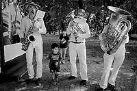 """Switzerland. Geneva. A music band is playing in the Bastions park during the opening of the collective photo exhibit """" Caravane de SolidaritÈ """". Saxophone, alto tenor horn and tuba. 26.06.2020 © 2020 Didier Ruef"""