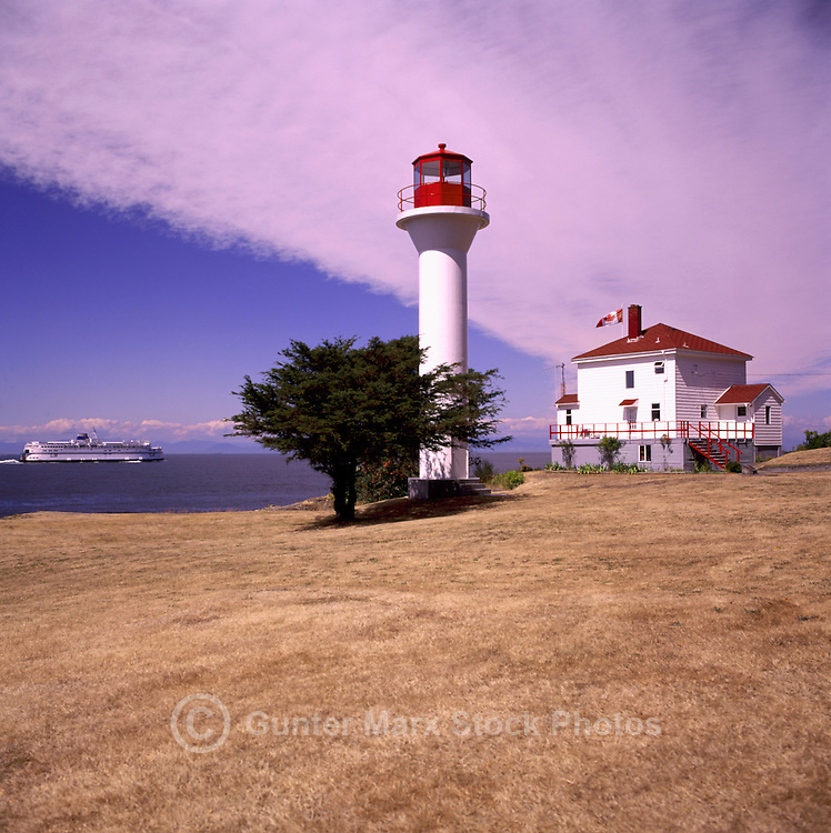 Mayne Island, Southern Gulf Islands, BC, British Columbia, Canada - BC Ferry passing Georgina Point Lighthouse (built 1885)