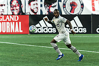 FOXBOROUGH, MA - SEPTEMBER 23: Zachary Brault-Guillard #15 of Montreal Impact looks to pass during a game between Montreal Impact and New England Revolution at Gillette Stadium on September 23, 2020 in Foxborough, Massachusetts.