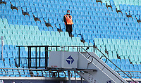16th May 2020, Red Bull Arena, Leipzig, Germany; Bundesliga football, Leipzig versus FC Freiburg;   A security guard with a mask stands in an empty spectator stand