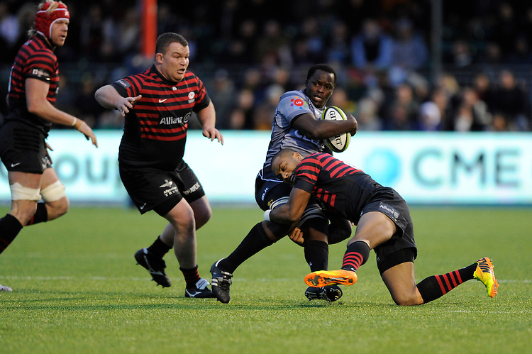 Tera Mtembu of Sharks is tackled by Michael Tagicakibau of Saracens during the Sanlam Private Investments Shield match between Saracens and the Cell C Sharks at Allianz Park on Saturday 25th January 2014 (Photo by Rob Munro)