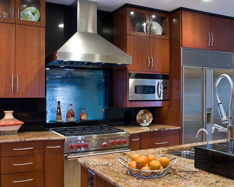 Granite countertops, Wolf range, stainless refrigerator, island with prep sink, custom glass backsplash