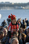 Welsh rugby fan watching the Welsh rugby team celebrate winning the Grand Slam in the Six Nations rugby tournament at The Senydd in Cardiff Bay..
