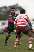 Reggie Sikivou looks for options as he makes a run towards Tavite Gadeisuva. Counties Manukau Premier Club Rugby game between Karaka and Onewhero, played at Karaka on Saturday June 25th 2016. Karaka won the game 15 - 10 after leading 10 - 3 at halftime.<br />  Photo by Richard Sprnger.