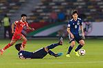 Kitagawa Koya of Japan (L) passes the ball to teammate Haraguchi Genki of Japan (R) during the AFC Asian Cup UAE 2019 Group F match between Oman (OMA) and Japan (JPN) at Zayed Sports City Stadium on 13 January 2019 in Abu Dhabi, United Arab Emirates. Photo by Marcio Rodrigo Machado / Power Sport Images