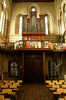 The interior of the Crimean Church in Beyoglu, Istanbul, Turkey, with a scenic panel by artist Erica Beard below the original hill organ