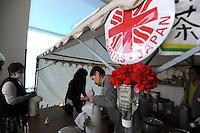 A Caritas center for Tsunami refugees at Kadonowaki Junior High School, near Sendai, Miyagi Prefecture,  Japan.  The Cardinal was touring the Tsunami hit areas around Sendai, Japan.<br /> <br /> photo by Richard Jones/ sinopix