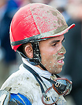SARATOGA SPRINGS - AUGUST 27: Jockey Joel Rosario for Governor Malibu #4 (not pictured) walks off the track with mud on his face after the Travers Stakes on Travers Stakes Day at Saratoga Race Course on August 27, 2016 in Saratoga Springs, New York. (Photo by Dan Heary/Eclipse Sportswire/Getty Images)