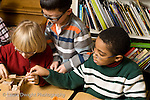 Elementary School New York Grade 2 three boys building with small wooden blocks during choice time horizontal