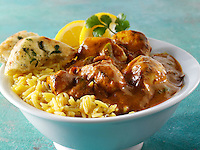 Chicken Vindaloo, pilau rice & naan bread. Tradional Bangladesh curry