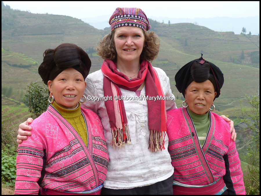 BNPS.co.uk (01202 558833)Pic: Unbound/MaryMonro/BNPS<br /> <br /> Mary Munro travelled across China to retrace her fathers footsteps in 2013.<br /> <br /> A hero British officer's dramatic escape from a Japanese POW camp can finally be told after his war diaries came to light 76 years later.<br /> <br /> Major John Monro was captured at the Battle of Hong Kong in December 1941 but two months later successfully escaped from the notorious Japanese POW camp at Sham Shui Po.<br /> <br /> He sneaked through a hole in the barbed wire at the perimeter of the water locked camp then waded into the sea, dragging a life raft he had built out of any materials he could muster behind him while trying to avoid detection.<br /> <br /> Upon reaching land, he disappeared into the dense Chinese countryside and embarked on an epic 1,200 mile trek across inhospitable terrain to reach China's wartime capital at Chongqing, reaching the destination two months later.