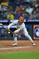 Eric Kennedy (30) of the Texas Longhorns lays down a bunt against the LSU Tigers in game three of the 2020 Shriners Hospitals for Children College Classic at Minute Maid Park on February 28, 2020 in Houston, Texas. The Tigers defeated the Longhorns 4-3. (Brian Westerholt/Four Seam Images)