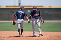 Cleveland Indians middle infielders Tyler Freeman (7) and Jhan Rodriguez (4) celebrate after turning a double play during an Extended Spring Training game against the Arizona Diamondbacks at the Cleveland Indians Training Complex on May 27, 2018 in Goodyear, Arizona. (Zachary Lucy/Four Seam Images)