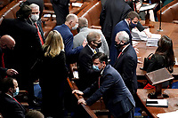 Rep. Jim Jordan, R-Ohio, speaks to House Minority Whip Steve Scalise, R-La., as a joint session of the House and Senate convenes to confirm the Electoral College votes cast in November's election, at the Capitol in Washington, Wednesday, Jan. 6, 2021. (Greg Nash/Pool via AP)