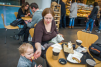 A mother looks after her son while breastfeeding her baby in a museum cafe.<br /> <br /> London, England, UK<br /> 08/03/2015<br /> <br /> © Paul Carter / wdiip.co.uk