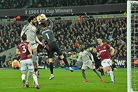 lukasz Fabianski of West Ham United jumps and catches a cross during West Ham United vs Liverpool, Premier League Football at The London Stadium on 4th February 2019