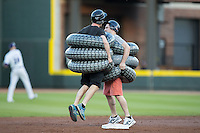 Two fans compete in a race wearing blow-up tires between innings of the Carolina League game between the Myrtle Beach Pelicans and the Winston-Salem Dash at BB&T Ballpark on April 18, 2016 in Winston-Salem, North Carolina.  The Pelicans defeated the Dash 6-4.  (Brian Westerholt/Four Seam Images)