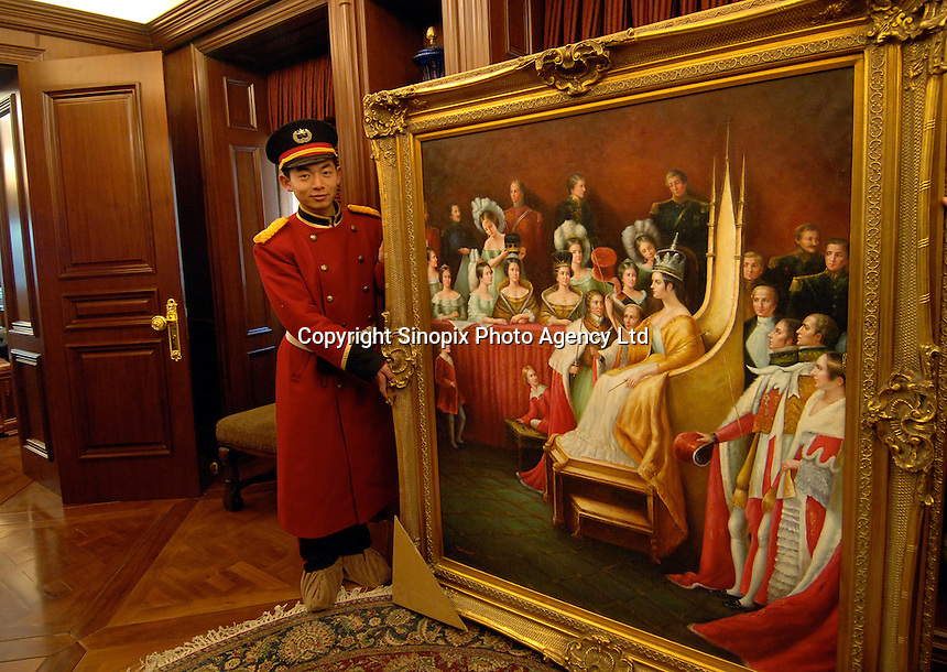 A replica european-style painting is installed in the library in a houses in the Palais de Fortune luxury development in Beijing, China. The development consists of 172 luxury mansions selling for over 2 million pounds each. The development is a heaven for China's super-rich terrified of kidnap and murder. The mansions are packed together and will form a dense community of millionaires..04 Feb 2006