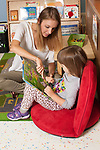 Education Preschool 3-4 year olds female therapist or SEIT working with girl in classroom