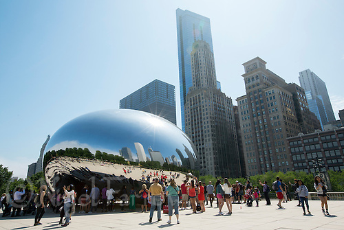 26 JUN 2014 - CHICAGO, USA - Visitors photograph themselves in the Cloud Gate, aka the Bean, a highly polished metal sculpture by Anish Kapoor standing in Millennium Park in Chicago in the USA (PHOTO COPYRIGHT © 2014 NIGEL FARROW, ALL RIGHTS RESERVED)