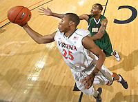 Dec. 20, 2010; Charlottesville, VA, USA; Virginia Cavaliers forward Akil Mitchell (25) grabs a rebound in front of Norfolk State Spartans forward Tim Zephyr (5) during the game at the John Paul Jones Arena. Virginia won 50-49. Mandatory Credit: Andrew Shurtleff