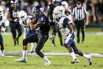 TCU Horned Frogs and West Virginia Mountaineers in action during the game between the West Virginia Mountaineers and the TCU Horned Frogs at the Amon G. Carter Stadium in Fort Worth, Texas.