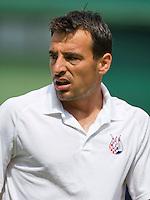 29-06-13, England, London,  AELTC, Wimbledon, Tennis, Wimbledon 2013, Day six, Ivan Dodig (CRO)<br /> <br /> <br /> <br /> Photo: Henk Koster