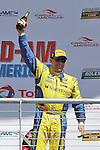 Paul Dalla Lana celebrates after winning the GS class Continental Tire race at the Circuit of the Americas race track in Austin,Texas...