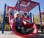 5-year-old Jessica Joy Lowden tries out the new slide during the grand opening of Inspiration Station, located at Dick Taylor Park in Reno.  The Junior League of Reno and the City of Reno celebrated the opening of the regions only universally accessible playground on Saturday afternoon, October 20, 2012.