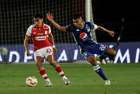 BOGOTÁ-COLOMBIA, 15-01-2020: Jhon Duque de Millonarios y Fabian Sambueza de Independiente Santa Fe disputan el balón, durante partido Millonarios y el Independiente Santa Fe, por el Torneo ESPN 2020, jugado en el estadio Nemesio Camacho El Campin de la ciudad de Bogotá. / Jhon Duque of Millonarios and Fabian Sambueza of Independiente Santa Fe vie for the ball, during a match between Millonarios and Independiente Santa Fe, for the ESPN Tournament 2020, played at the Nemesio Camacho El Campin stadium in the city of Bogota. Photo: VizzorImage / Luis Ramírez / Staff.