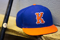 A Kingsport Mets cap sits on the bench in the home dugout during the game against the Elizabethton Twins at Hunter Wright Stadium on July 8, 2015 in Kingsport, Tennessee.  The Mets defeated the Twins 8-2. (Brian Westerholt/Four Seam Images)