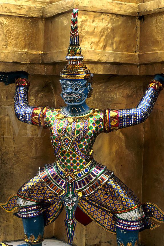 Closeup of beautiful gold decorations at Emerald Buddha in Grand Palace in Bangkok Thailand
