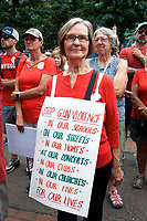 Sue Stine of Sudbury MA at a Moms Demand Action for Gun Sense in America recess rally to urge Congress to vote on Senate Bill 42 to implement background checks and red flag laws, and call for an assault weapons ban at Boston City Hall Plaza Boston MA 8.18.19
