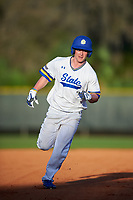 South Dakota State Jackrabbits left fielder Jamie Berg (24) rounds the bases on a home run by Luke Ira (not shown) during a game against the Northeastern Huskies on February 23, 2019 at North Charlotte Regional Park in Port Charlotte, Florida.  Northeastern defeated South Dakota State 12-9.  (Mike Janes/Four Seam Images)