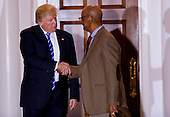 United States President-elect Donald Trump (L) shakes hands with Bob Woodson (R) at the clubhouse of Trump International Golf Club, November 19, 2016 in Bedminster Township, New Jersey. <br /> Credit: Aude Guerrucci / Pool via CNP