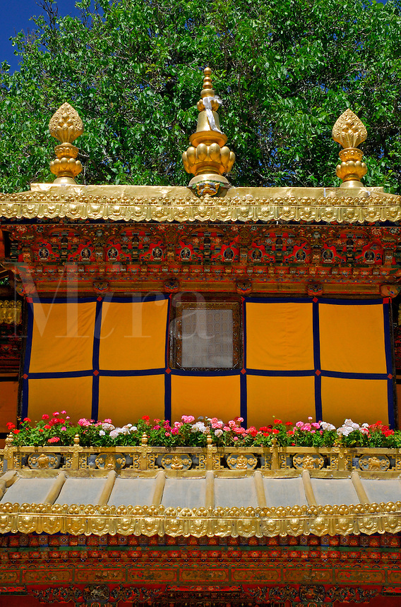 Detail of the Viewing Pavilion with gold finials representing the Noble Eightfold Path and the Nirvana Stupa, at the Summer Palace, or Norbulingka, founded by 7th Dalai Lama in 1755, Lhasa, Tibet, China.