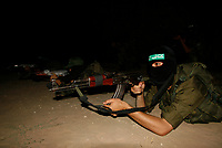 """Palestinian gunmen from Alqassam Brigads training after tow day  of a cease fire, near the border with Israel, middle of Gaza strip in alburage refugee camp , Satruday, June 22, 2008. Guns went quiet as a six-month truce between Israel and Gaza Strip militants took effect early Thursday, marred only by widespread skepticism about its ability to hold. The cease-fire, which Egypt labored for months to conclude, aims to bring an end to a year of fighting that has killed seven Israelis and more than 400 Palestinians many of them civilians since the Islamic militant group Hamas wrested control of Gaza a year ago<br /> . """"photo by Fady Adwan"""""""