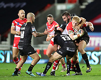 20th November 2020; Totally Wicked Stadium, Saint Helens, Merseyside, England; BetFred Super League Playoff Rugby, Saint Helens Saints v Catalan Dragons; James Graham of St Helens is tackled by Julian Bousquet of Catalan Dragons