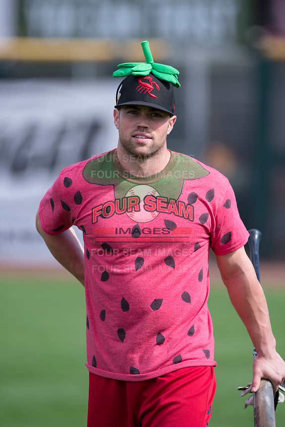 "Scottsdale Scorpions catcher Wade Wass (8), of the Los Angeles Angels organization, walks onto the field in his ""Strawberry"" costume prior to an Arizona Fall League game against the Glendale Desert Dogs on October 31, 2017 at Scottsdale Stadium in Scottsdale, Arizona. The Scorpions defeated the Desert Dogs 6-2. (Zachary Lucy/Four Seam Images)"