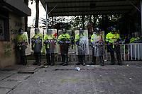BOGOTA - COLOMBIA, 10-09-2020: Miembros de la Policía montan guardia frente al CAI de Villa Luz durante el segundo día de protestas causadas por el asesinato del abogado Javier Ordoñez, abogado de 46 años, a manos de efectivos de la Policía de Bogotá el pasado miércoles 09 de septiembre de 2020 en el barrio Villa Luz al noroccidente de Bogotá (Colombia). En lo que va corrido del 2020 la alcaldía de Bogotá ha recibido 137 denuncias  de abuso policial de las cuales la Policía acusa recibido de 38.  / Members of the Police stand guard in front of the CAI of Villa Luz during the second day of protests caused by the murder of lawyer Javier Ordoñez, a 46-year-old lawyer, at the hands of members of the Bogotá Police on Wednesday, September 9, 2020 in Villa Luz neighborhood in the northwest of Bogotá (Colombia). So far in 2020 the Bogotá mayor's office has received 137 complaints of police abuse of which the Police accuse they have received 38. Photo: VizzorImage / Johan Rugeles / Cont