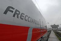 """- high-speed train Eurostar """"Red Arrow"""" at Milan Central Station....- treno ad alta velocità Eurostar """"Freccia Rossa"""" alla Stazione Centrale di Milano"""