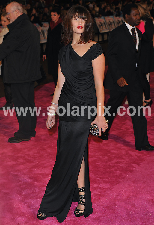 **ALL ROUND PICTURES FROM SOLARPIX.COM** **WORLDWIDE SYNDICATION RIGHTS** .Red carpet arrivals at the World premiere of St Trinians - The Legend of Fritton's Gold. Held at the Empire, Leicester Square, London, UK. 9 December 2009 ..This pic: Gemma Arterton..JOB REF: 10369 SSD DATE: 09_12_2009 **MUST CREDIT SOLARPIX.COM OR DOUBLE FEE WILL BE CHARGED** **MUST NOTIFY SOLARPIX OF ONLINE USAGE** **CALL US ON: +34 952 811 768 or LOW RATE FROM UK 0844 617 7637**